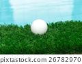 Golf ball on grass 26782970