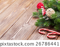 Candy cane and christmas tree on wooden table 26786441
