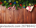 Fir tree branch with christmas lights, gift box  26786442