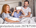 family being playful at home 26787599