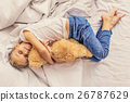 Lovely child holding teddy bear 26787629