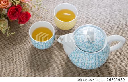 hot green tea and tea pot on sackcloth. 26803970