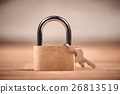 Padlock and keys on a brown wooden table 26813519
