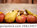 Apples and pears on a table as rustical background 26813957