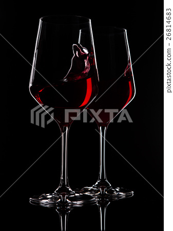Glasses of red wine with reflection on black 26814683