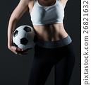 Beautiful woman holding a football gray background 26821632
