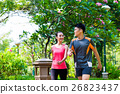 Asian Chinese man and woman jogging in city park 26823437