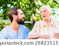 Nurse having chat with woman in nursing home 26823515
