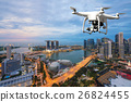 Drone with digital camera flying over Singapore 26824455