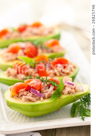 Stuffed avocado on tray. 26825746