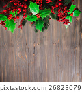 Holly and fir twigs on wood wall 26828079