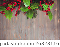 Holly and fir twigs on wood wall 26828116