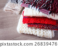 Pile of warm knitted woolen scarves and mitten 26839476