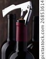 Bottle of red wine and corkscrew 26853614