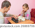 Dad teaches his daughter to make first moves  26869706