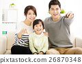 Happy Attractive Young  Family watching the tv 26870348