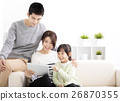 Happy Attractive Young  Family watching the tablet 26870355