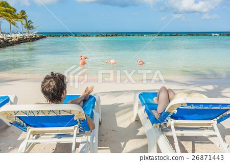 Flamingos beach in Aruba. Young couple resting 26871443