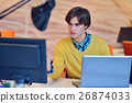 Man working in office in front on notebook 26874033