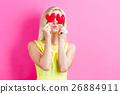 A woman with a heart cushion 26884911