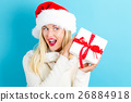 A woman holding a present 26884918