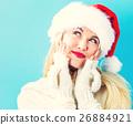 ผู้หญิงสวมหมวกซานต้า 26884921