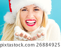 A woman wearing a Santa hat 26884925