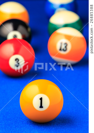 Billiard balls in a blue pool table. 26885388