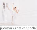 Elegant ballet dancer doing extension exercises 26887782