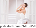 Tender woman posing with arms bent in elbow 26887859