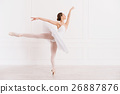 Graceful woman standing in ballet position 26887876