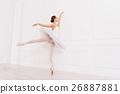 Flexible ballerina posing on tiptoes 26887881