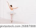 Elegant female standing in ballet position 26887888