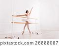 Graceful girl training in ballet class 26888087