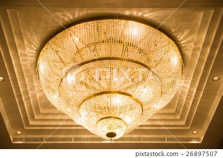 ceiling crystal chandelier in luxury room 26897507