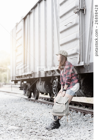 Hipster woman waiting train on railway station. 26898428