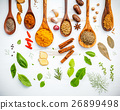Various herbs and spices in wooden spoons. 26899498