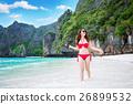 Sexy girl wearing a red bikini at the beach. 26899532