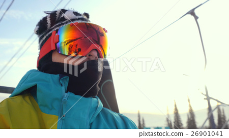 Portrait of Skier in glasses skiing downhill in 26901041