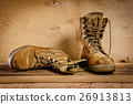 old military boots on the table 26913813
