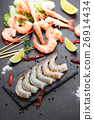 Raw and boiled shrimps on a stone plate 26914434