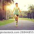 young fitness woman runner tying shoelace on road 26944855