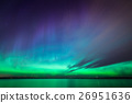 Northern lights over lake in finland 26951636
