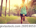 young sporty asian woman running at tropical park 26959050