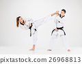 The karate girl and boy with black belts 26968813