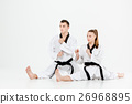 The karate girl and boy with black belts 26968895