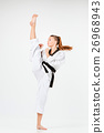 The karate girl with black belt 26968943