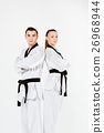The karate girl and boy with black belts 26968944