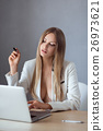 Sexy businesswoman on working place with laptop 26973621