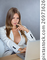 Sexy businesswoman on working place with laptop 26973626